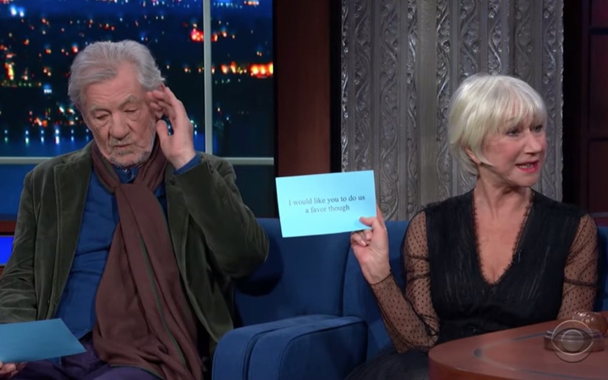 Helen Mirren and Ian McKellen read from cards on the Late Show stage.
