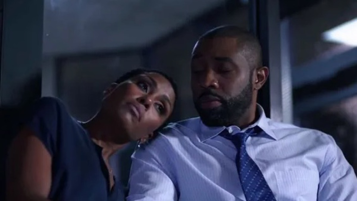 Lynn rests her head on Jefferson's shoulder in The CW's Black Lightning.