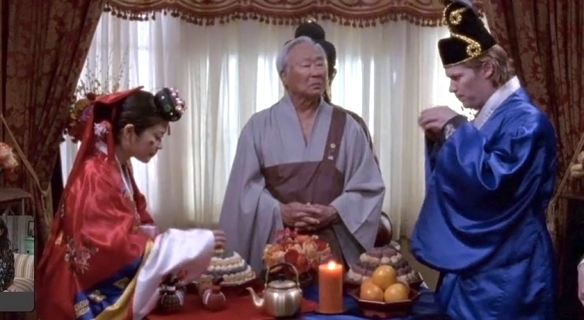 Ralph Ahn performing Lane and Zack's show wedding on Gilmore Girls.