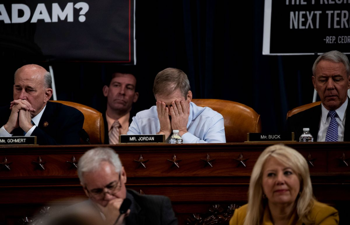 Rep. Jim Jordan (R-OH) puts his face in his hands during a public impeachment inquiry hearing