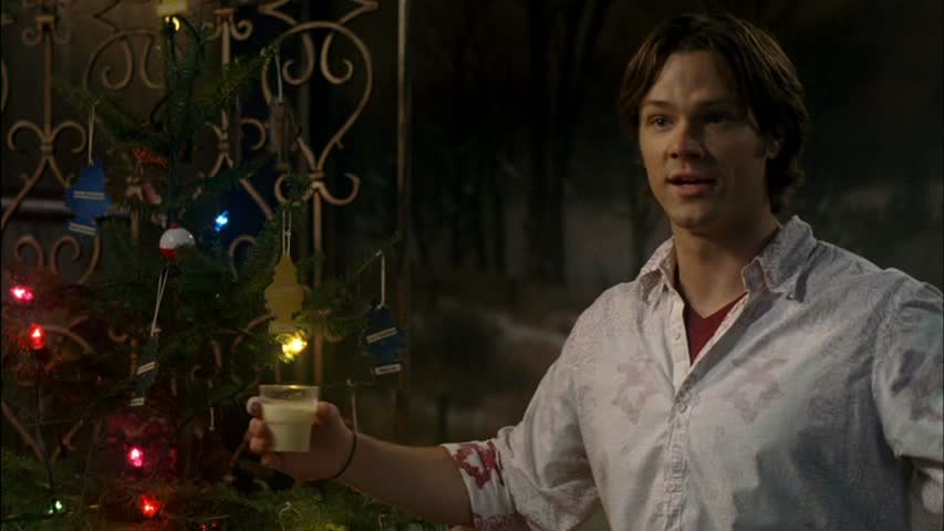 Sam winchester and a tree. A very supernatural christmas. Screen cap.