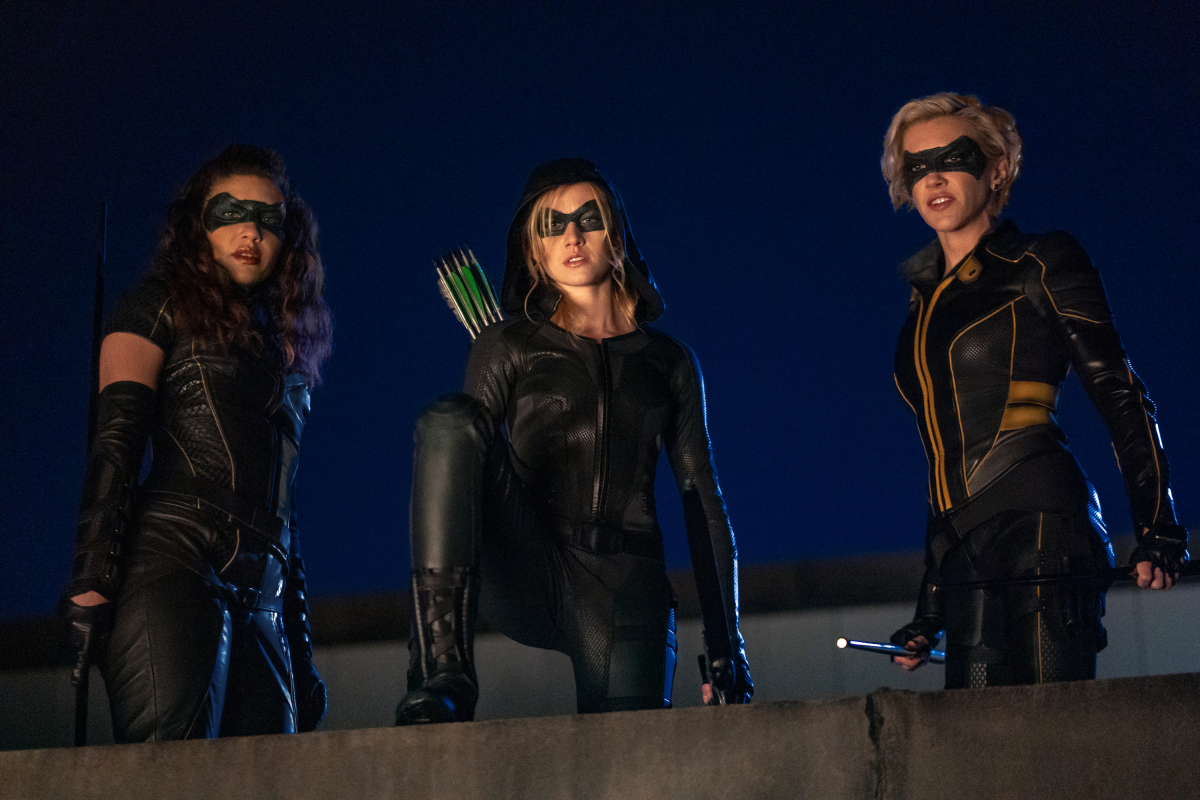 """Arrow -- """"Green Arrow & The Canaries"""" -- Image Number: AR809b_0627r.jpg -- Pictured (L-R): Juliana Harkavy as Dinah Drake/Black Canary, Katherine McNamara as Mia and Katie Cassidy as Laurel Lance/Black Siren -- Photo: Colin Bentley/The CW -- © 2020 The CW Network, LLC. All Rights Reserved."""
