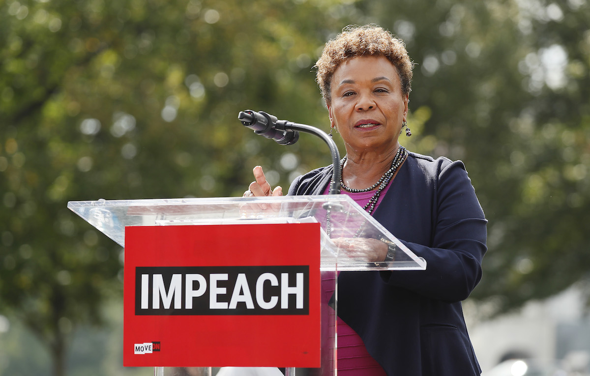 Rep. Barbara Lee (D-CA) speaks from a podium at the Impeachment Now! rally