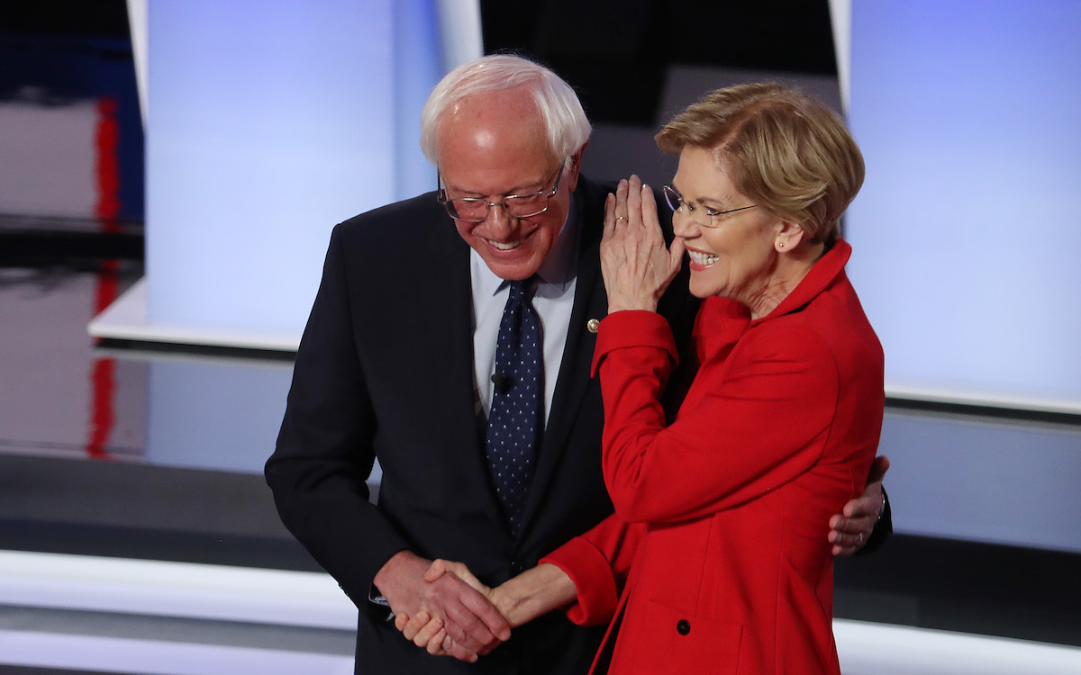 Democratic presidential candidate Sen. Bernie Sanders (I-VT) (R) and Sen. Elizabeth Warren (D-MA) hug and greet each other at the start of the Democratic Presidential Debate