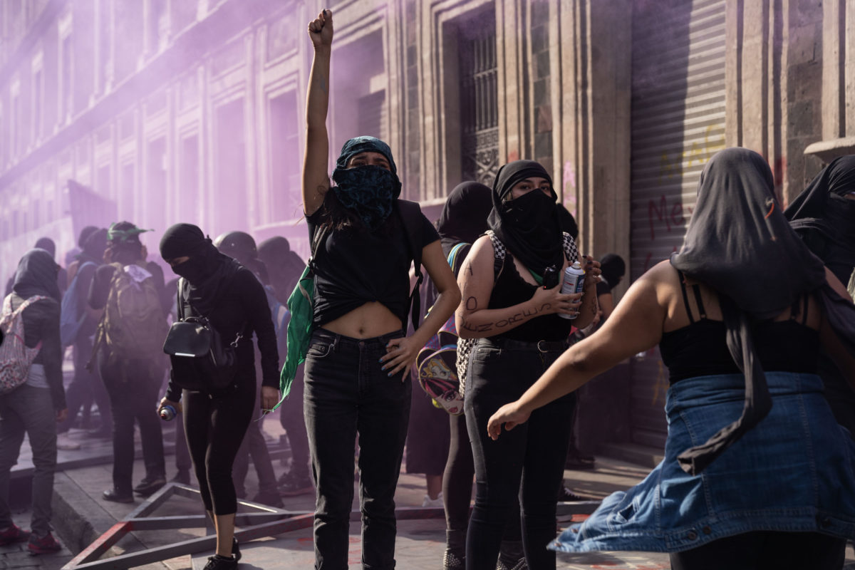 MEXICO CITY, MEXICO - MARCH 08: Demonstrators clah with police during a rally on International Women's Day on March 8, 2020 in Mexico City, Mexico. (Photo by Toya Sarno Jordan/Getty Images)