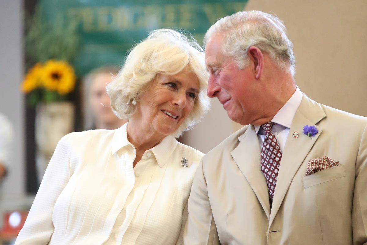 BUILTH WELLS, WALES - JULY 04: Prince Charles, Prince of Wales and Camilla, Duchess of Cornwall look at eachother as they reopen the newly-renovated Edwardian community hall The Strand Hall during day three of a visit to Wales on July 4, 2018 in Builth Wells, Wales. (Photo by Chris Jackson/Getty Images)