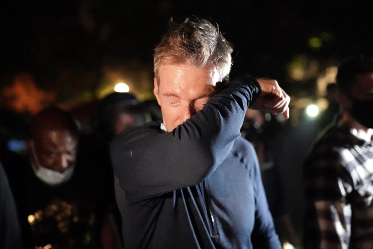 PORTLAND, OR - JULY 22: Portland Mayor Ted Wheeler reacts after being exposed to tear gas fired by federal officers while attending a protest against police brutality and racial injustice in front of the Mark O. Hatfield U.S. Courthouse on July 22, 2020 in Portland, Oregon. State and city elected officials have called for the federal officers to leave Portland as clashes between protesters and federal police continue to escalate. (Photo by Nathan Howard/Getty Images)