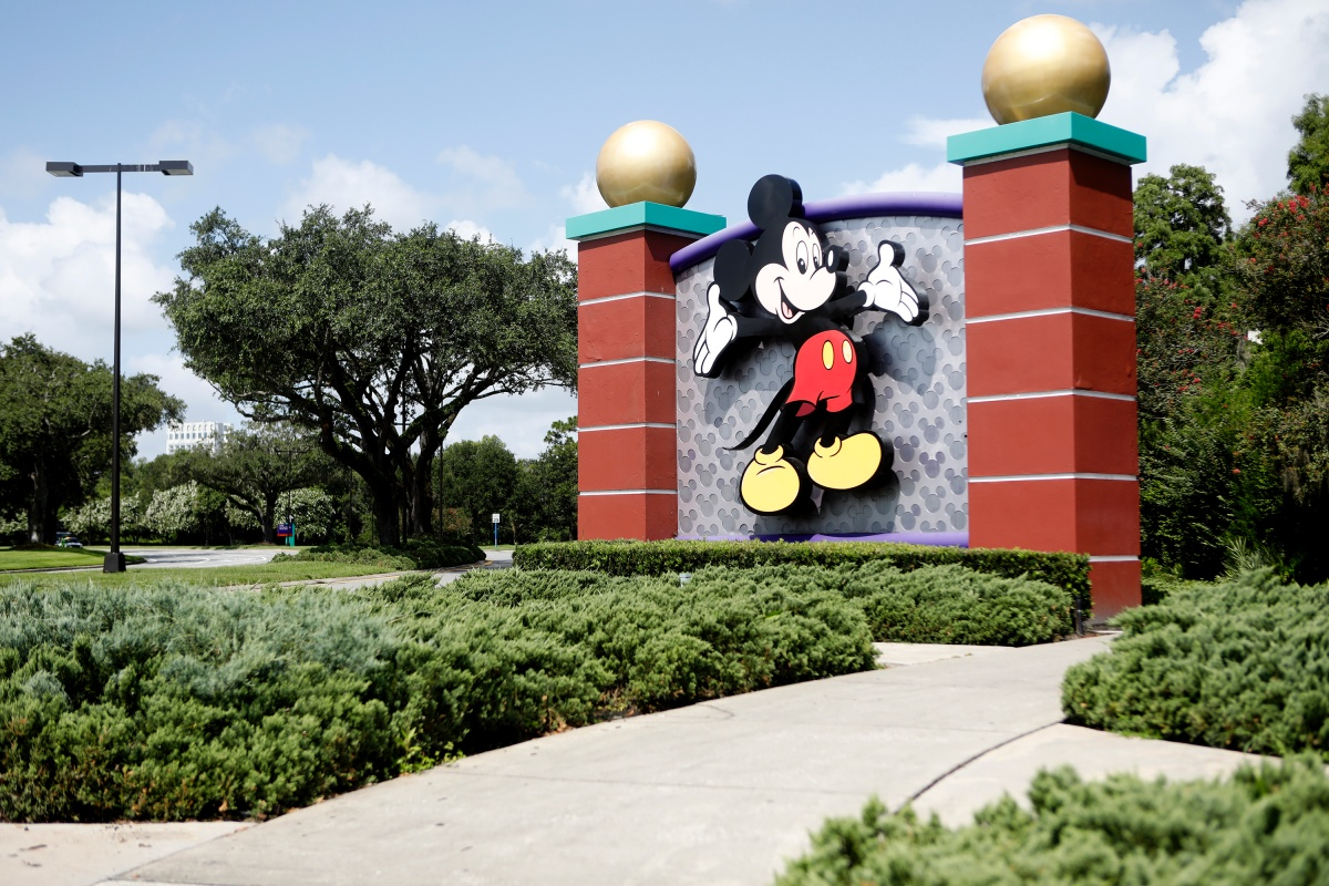 Mandatory masks, meeting Mickey at a distance as Walt Disney World reopens