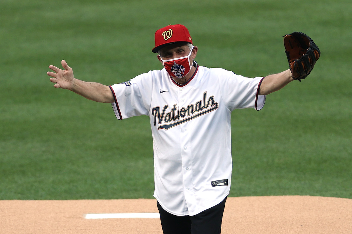 Dr. Anthony Fauci, director of the National Institute of Allergy and Infectious Diseases reacts after throwing out the ceremonial first pitch prior to the game between the New York Yankees and the Washington Nationals