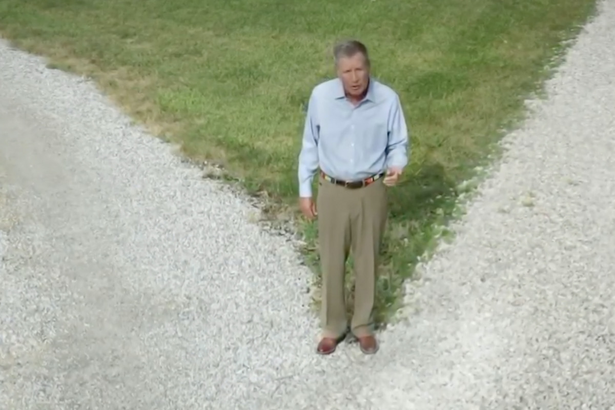In this screenshot from the DNCC's livestream of the 2020 Democratic National Convention, Republican, Former Ohio Governor John Kasich stands in a field.