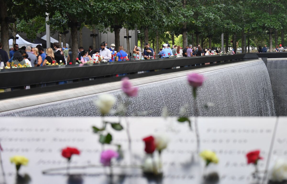 People gather at the 9/11 Memorial & Museum in New York on September 11, 2020, as the US commemorates the 19th anniversary of the 9/11 attacks. (Photo by Angela Weiss / AFP) (Photo by ANGELA WEISS/AFP via Getty Images)