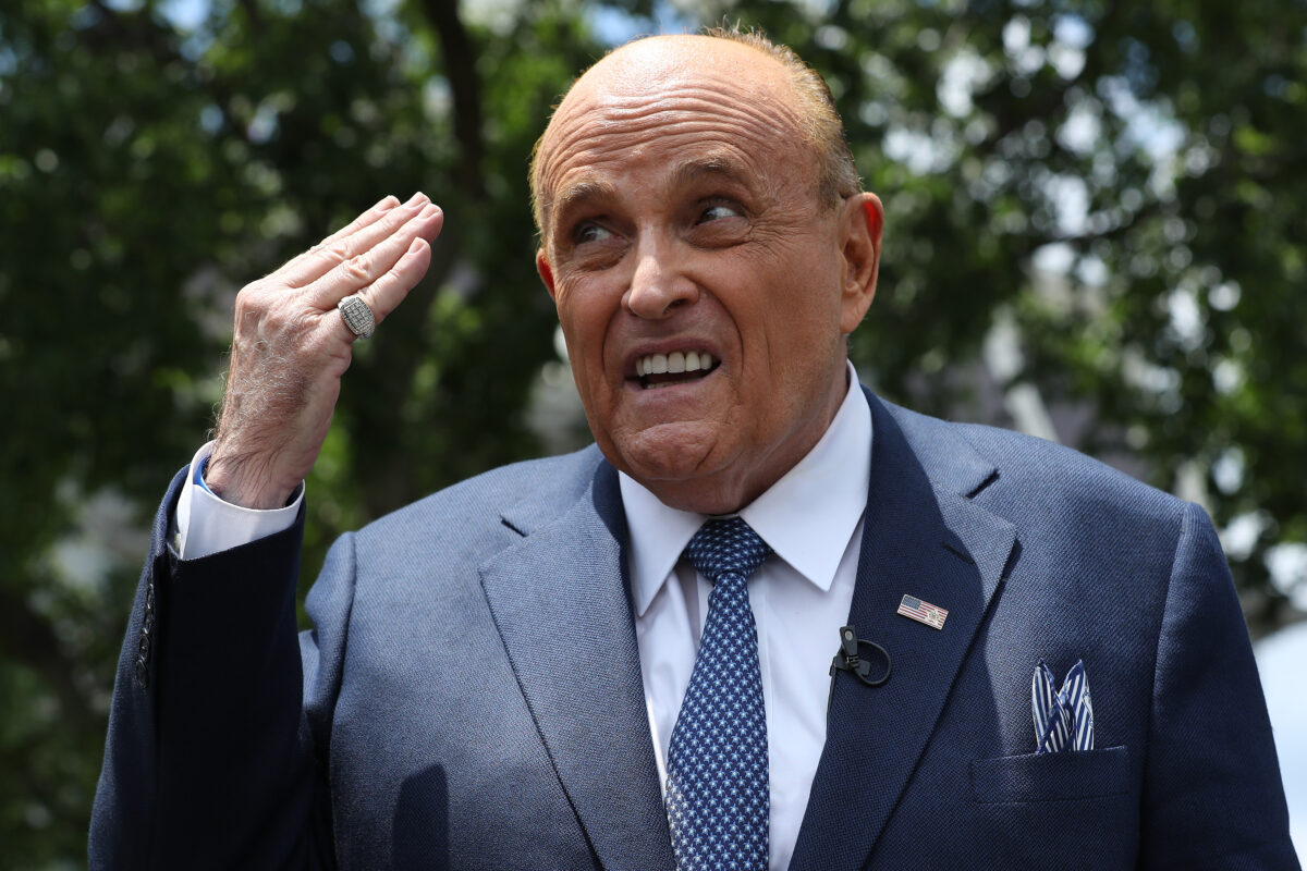 WASHINGTON, DC - JULY 01: President Donald Trump's lawyer and former New York City Mayor Rudy Giuliani talks to journalists outside the White House West Wing July 01, 2020 in Washington, DC. Giuliani did an on-camera interview with One America News Network's Chanel Rion before talking to other journalists about Vice President Joe Biden and the news that Russian intelligence may have paid Taliban operatives to kill U.S. troops in Afghanistan. (Photo by Chip Somodevilla/Getty Images)