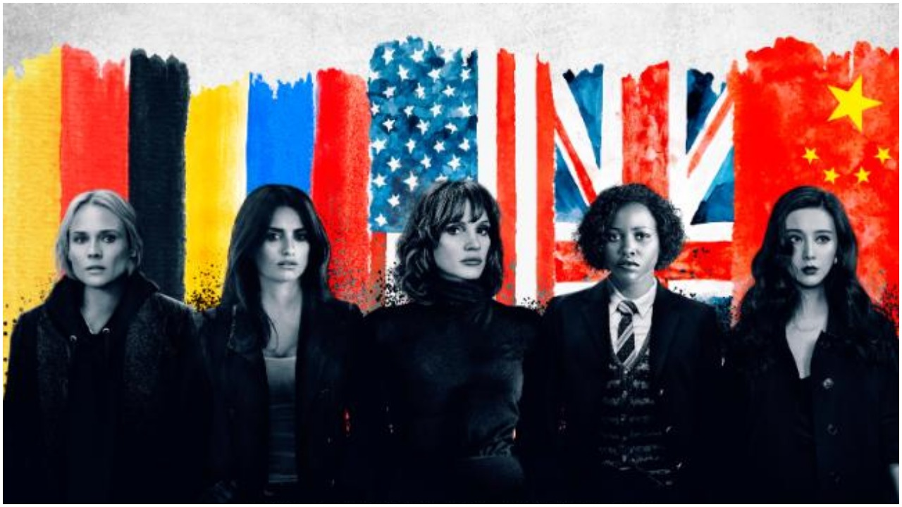 The cast of The 355 standing in front of their countries' flags.