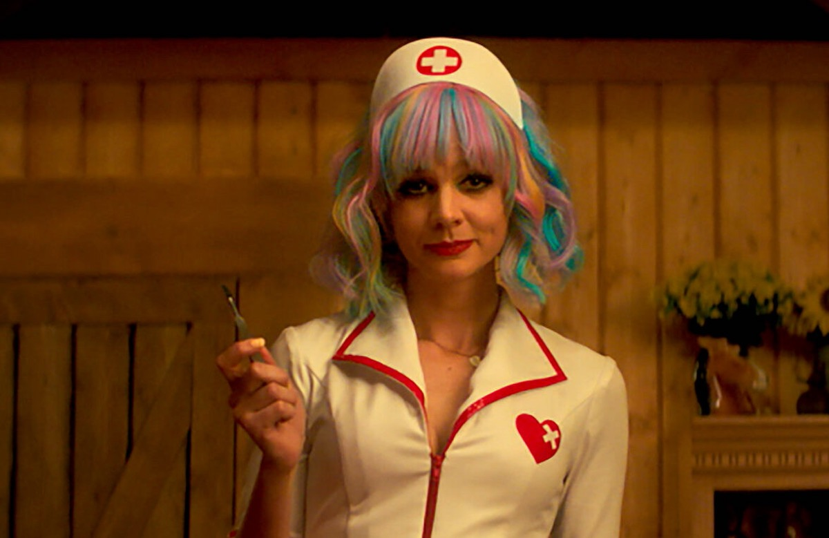 Cassie dressed as a nurse, holding up a scalpel in Promising Young Woman.