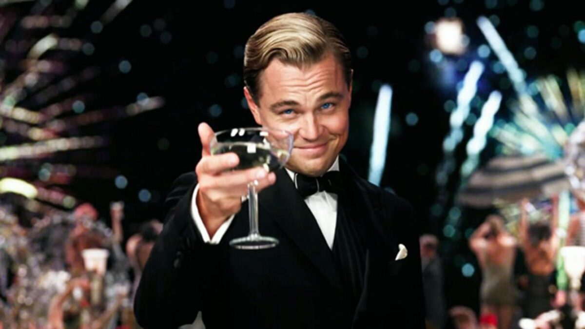 leo raises a glass in the great gatsby