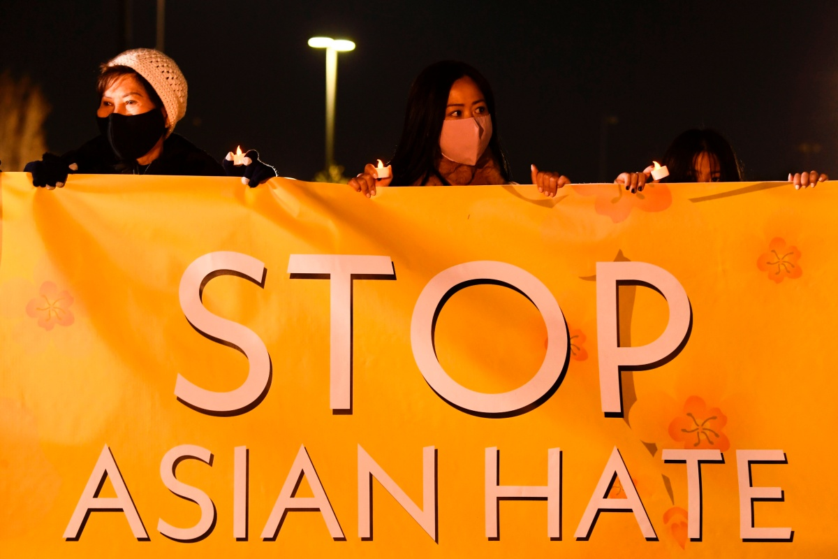 "People hold lights during a vigil organized by Nailing It For America for those who have died from Covid-19 and to ""Stop Asian Hate"" on March 4, 2021 in Fountain Valley, California. - Orange County community volunteers formed the message of ""Stop Asian Hate"" with luminaries as reports of hate crimes against Asian Americans have increased since the beginning of the Covid-19 pandemic. (Photo by Patrick T. FALLON / AFP) (Photo by PATRICK T. FALLON/AFP via Getty Images)"