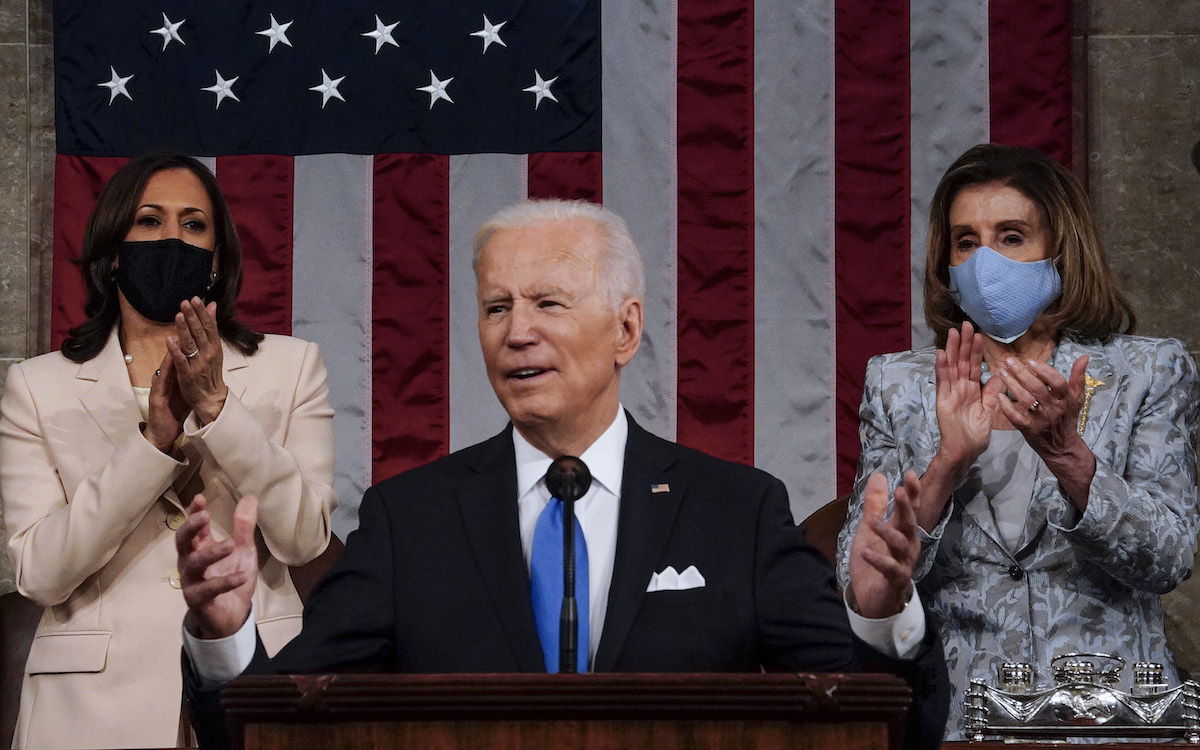 President Joe Biden addresses a joint session of Congress, with Vice President Kamala Harris and House Speaker Nancy Pelosi (D-Calif.) on the dais behind him