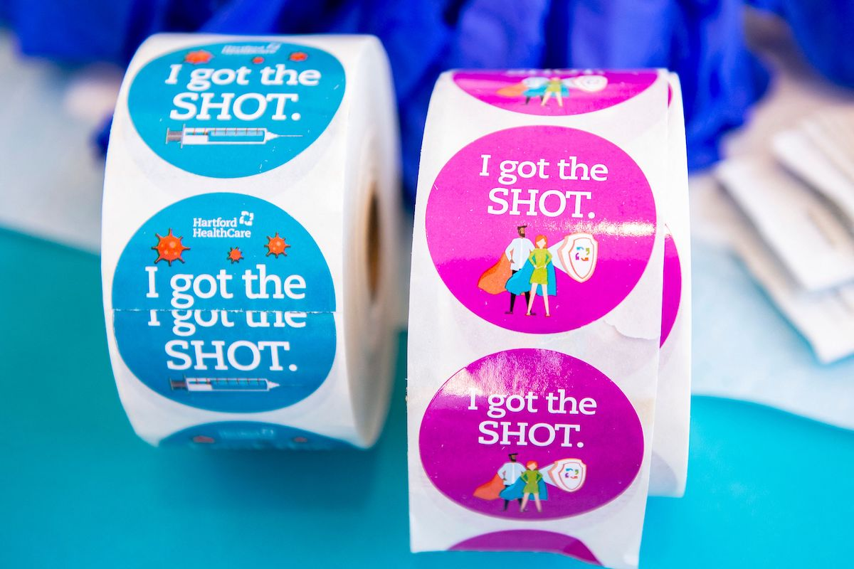 """Stickers reading """"I got the shot"""""""