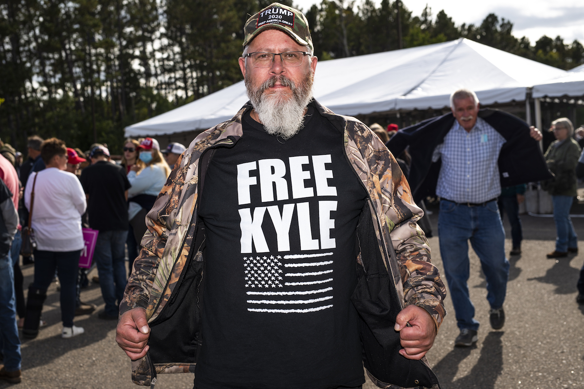 "A man wears a Trump hat and a shirt that says ""Free Kyle"", referencing Kyle Rittenhouse"