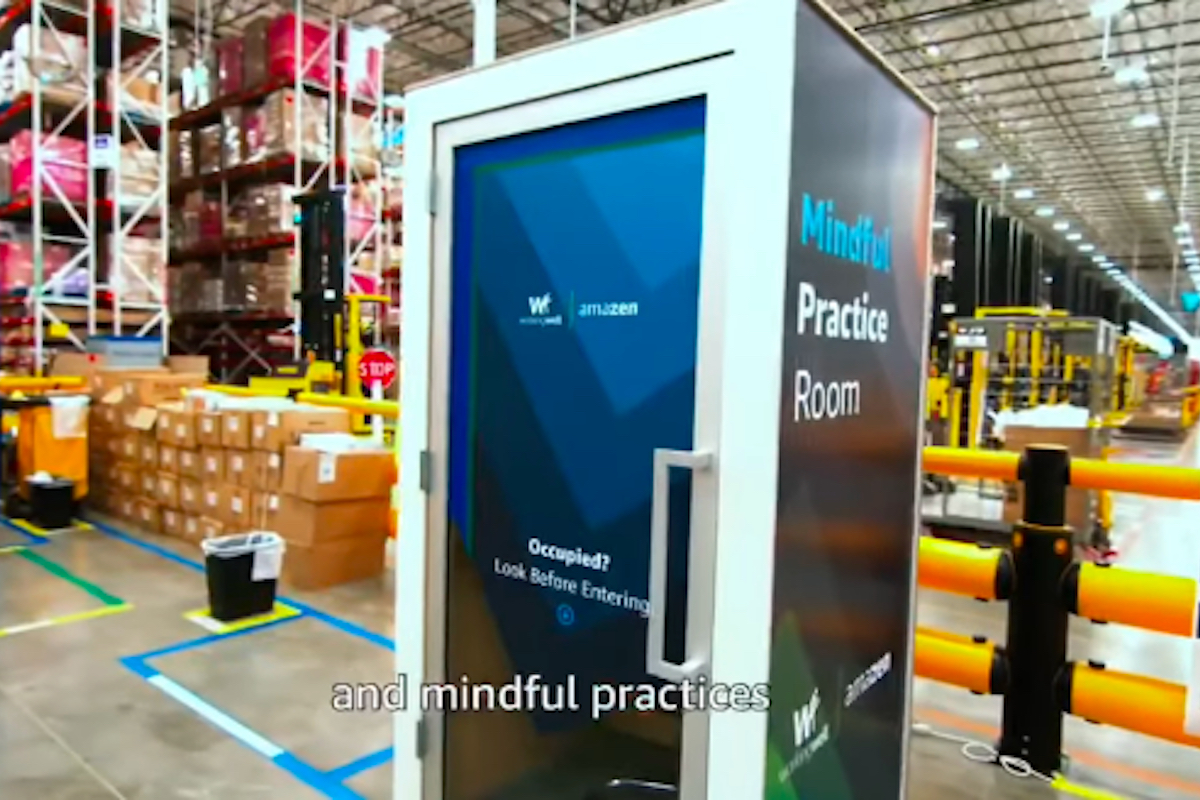 """a booth in the middle of an Amazon Warehouse labeled """"Mindful Practice Room"""""""
