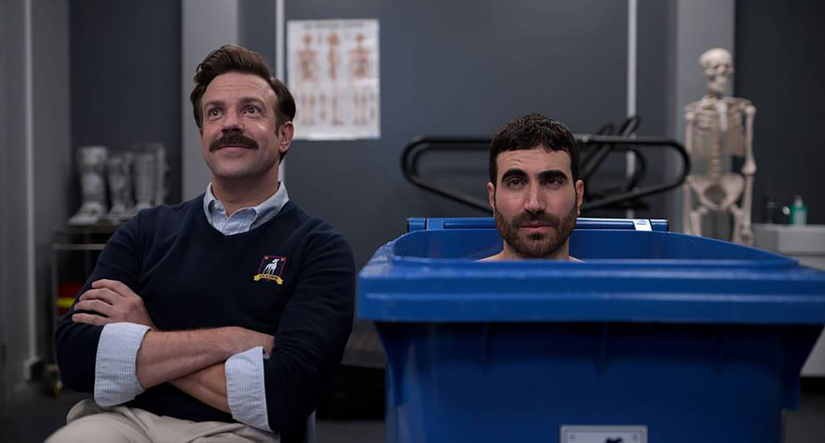 Ted Lasso and Roy Kent sitting