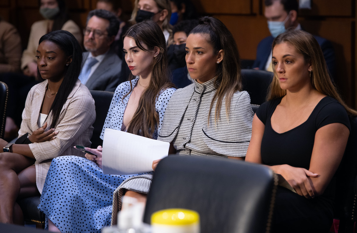 US gymnasts (L-R) Simone Biles, McKayla Maroney, Aly Raisman and Maggie Nichols sit next to each other before testifying during a Senate Judiciary hearing